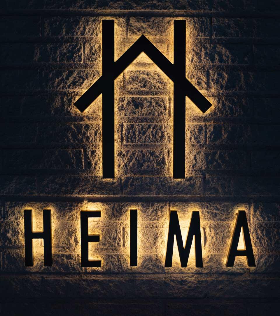Heima logotype bakrgrundsbelyst